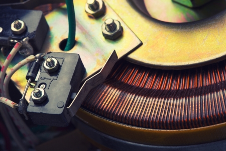 Closeup of copper inductor in electrical transformer photo