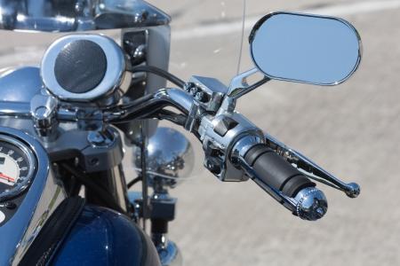 chromed: Chromed handlebar of a motorcycle