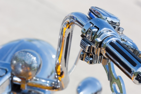 Chromed handlebar of a motorcycle photo