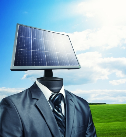 Businessman with a solar panel instead of a head photo