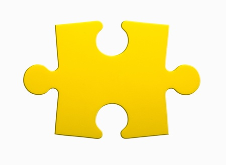 one piece: Closeup of jigsaw puzzle piece isolated on white