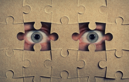 keek: Eyes look out from the holes in jigsaw puzzle