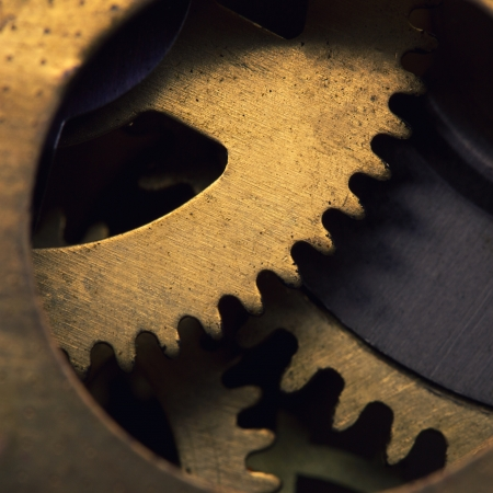 Closeup of gears inside old clock mechanism photo