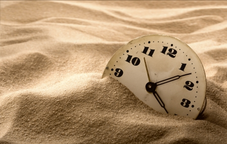 Old face of clock in sand photo