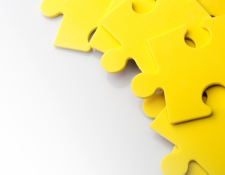 puzzling: Closeup of jigsaw puzzle pieces with space