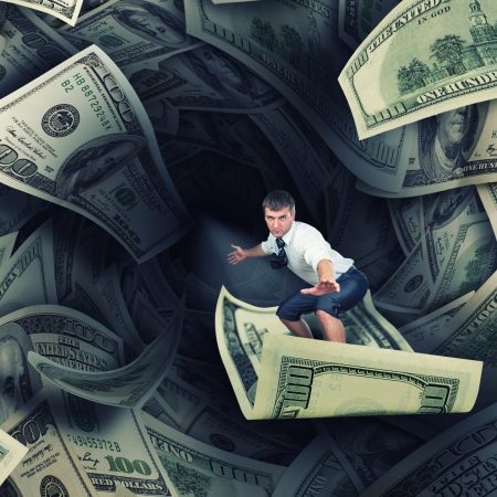 Confident surfer riding the tunnel of dollar bills