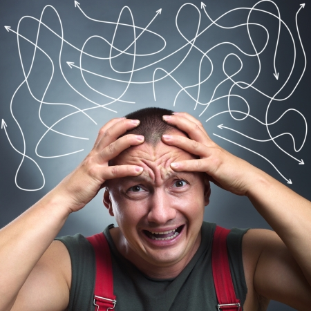 shoked: Portrait of stressed man with many arrows pointed in different directions