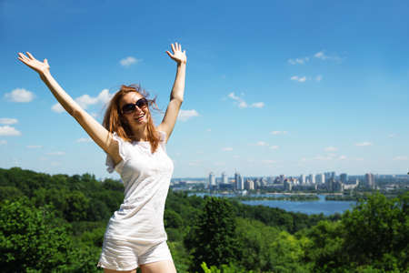 Excited young woman against cityscape Stock Photo - 21141625