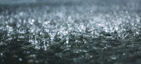 heavy: Drops of heavy rain on water Stock Photo