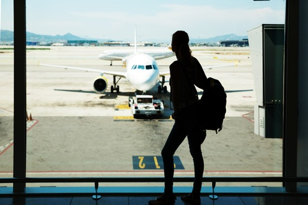 Silhouette of young woman waiting for the flight Stock Photo - 21205718