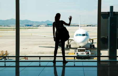 Silhouette of young woman waiting for the flight Stock Photo - 21205728
