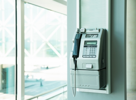 Modern payphone in office building photo