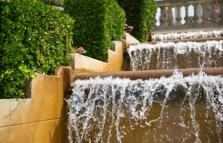 Cascade waterfall in city park photo