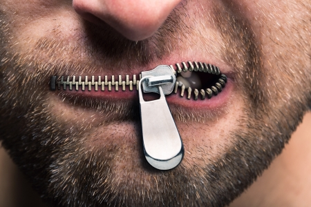 a communication: Insubordinate man with zipped mouth