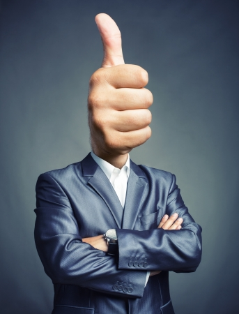 thumb's up: Portrait of businessman with thumbs up sign instead of the head