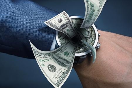 suck: Watch on businessman hand sucking money