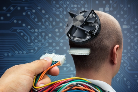 plugging: Hand plugging power cables into the head of cyborg Stock Photo