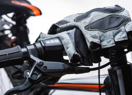 handlebar: Race gloves on bicycle handlebar Stock Photo