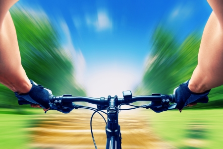 Man riding on a bicycle very fast, motion blur photo