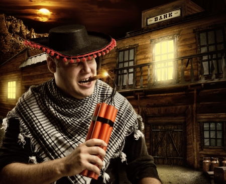 bank western: Serious cowboy mexican firing dynamite by cigar for bank robbery at night Stock Photo