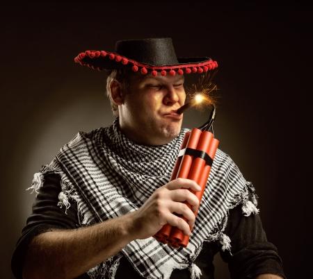 Serious cowboy mexican firing dynamite by cigar photo