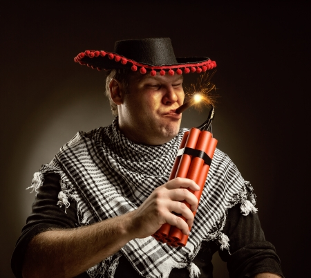 dynamite: Serious cowboy mexican firing dynamite by cigar