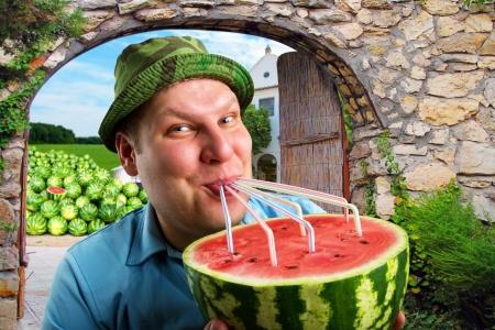 tubules: Cheerful farmer drinking watermelon juice through a tubules