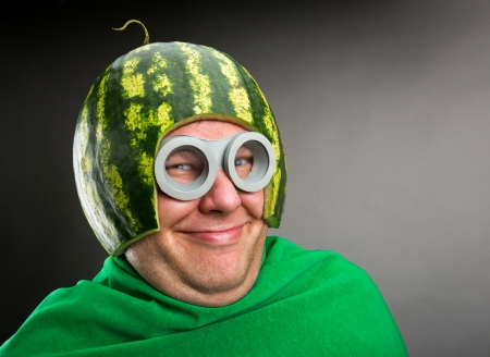 Funny man with watermelon helmet and googles looks like a parasitic caterpillar photo
