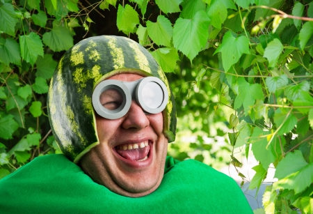 parasitic: Funny man with watermelon helmet and googles looks like a parasitic caterpillar
