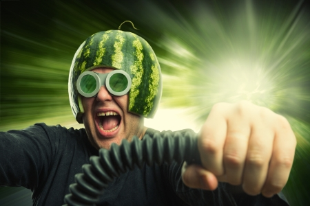 Bizarre man in a helmet from a watermelon riding fast