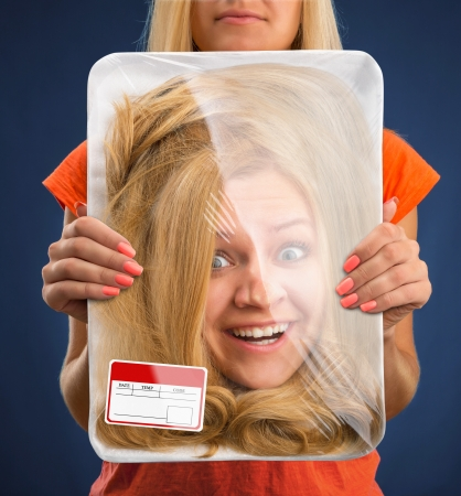 prepack: Surprised female head wrapped in food tray