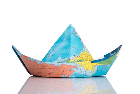world locations: Paper boat made of map. Isolated on white