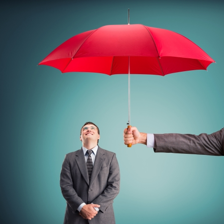 under: Cheerful businessman under an umbrella