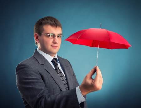 Businessman with an red umbrella photo