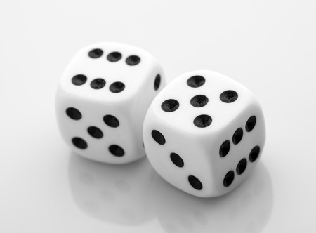 2 objects: Two dice isolated over white