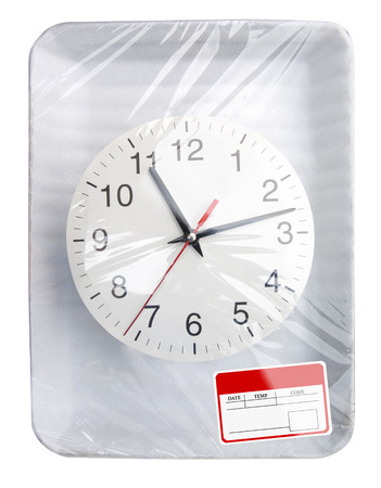 Wrapped plastic white food container with clock and blank label isolated photo