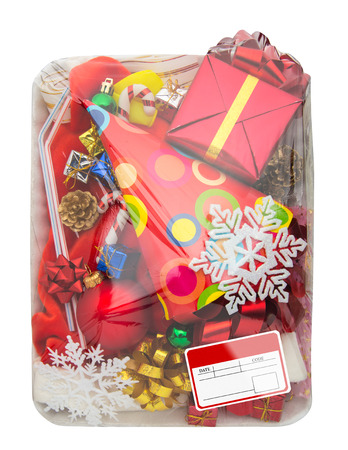 polythene film: Wrapped plastic white food container with colorful gifts box and blank label isolated