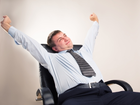 Office worker in a suit celebrates victory photo