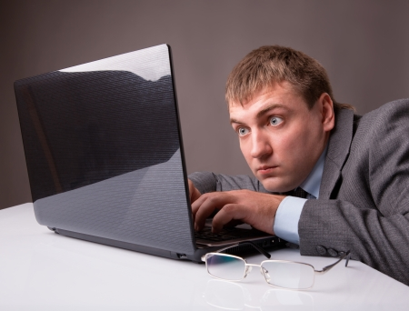 tired face: Office worker stares at the monitor with surprise