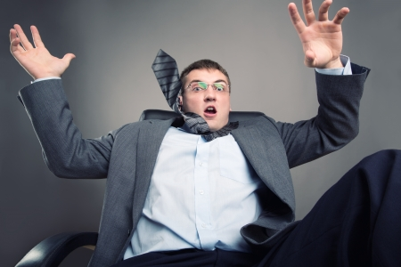 Frightened office worker put his hands up photo