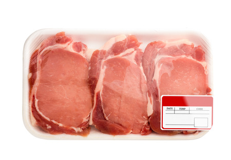 price cutting: Fresh red meat packed in a poly bag. Isolated over white. Stock Photo