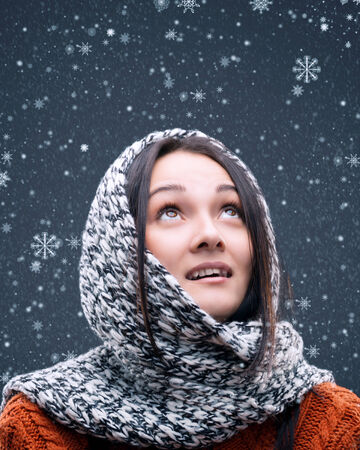 likable: snowflakes fall on the head of a young girl Stock Photo
