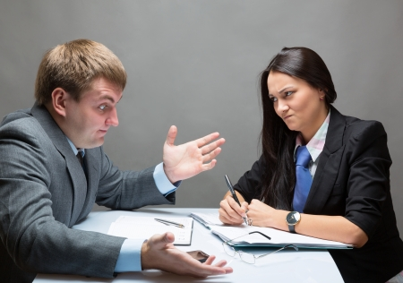 serious meeting: Two young caucasian office worker discussing contract Stock Photo