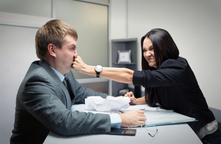 disrespect: Two young caucasian office worker starting to fight Stock Photo