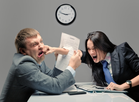 displeased businessman: Two young caucasian office worker starting to fight Stock Photo