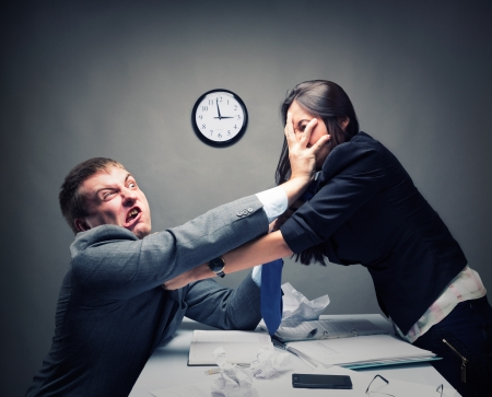 Two young caucasian office worker starting to fight Stock Photo
