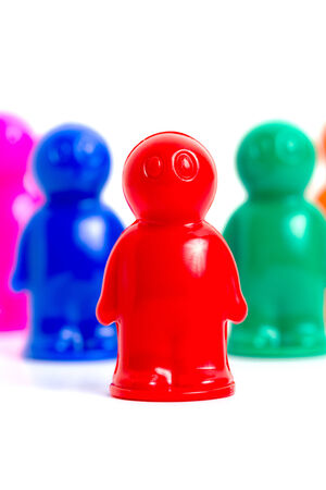 Colorful toy people group vertical image photo