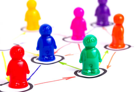 Networking, organizational groups or workgroups. Business concept illustrated with colorful toy people. photo