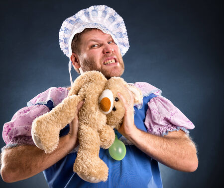 spiteful: Spiteful man with teddy bear in studio
