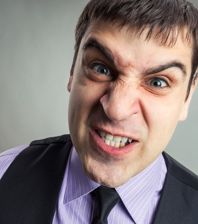 Businessman making faces closeup image photo